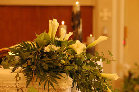 calla flowers on an altar in the church