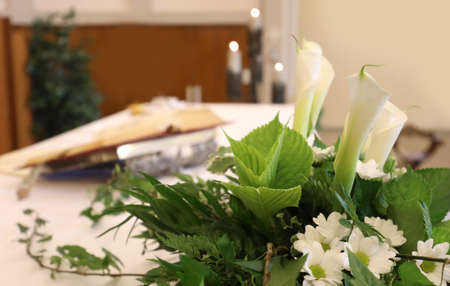 calla flowers on an altar in the church during religious rite