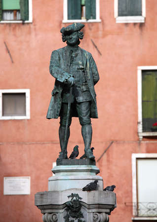 monument dedicated to the Italian writer Carlo Goldoni in Venice Banco de Imagens