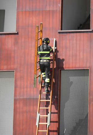 rescue exercises with the ladder and fireman with helmet in the fire station Reklamní fotografie