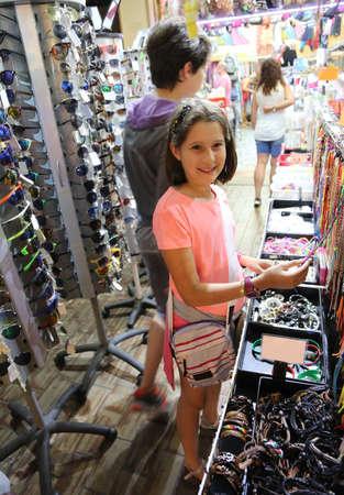 little girl buy object in the store