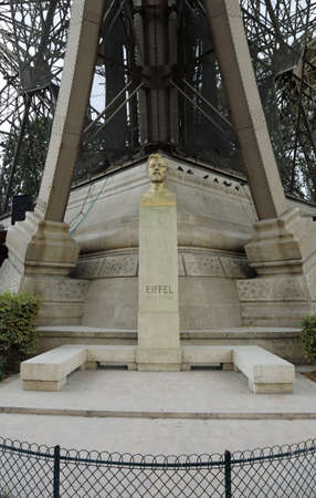Bust of engineer and architect Gustave Eiffel under his famous tower in Paris France