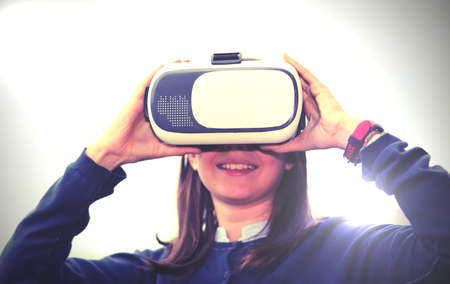 virtual reality headset and a little girl with old toned effect