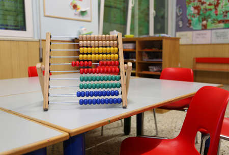 wooden abacus in the classroom to learn decimal numeral system to children Foto de archivo - 124656468
