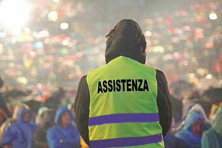 high visibility jacket and refractive inserts and a powerful spotlight with text ASSISTENZA that means Assistance in Italian language Imagens