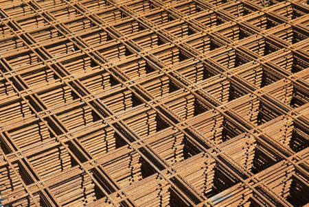 background of rusty welded net at the construction site to facilitate the pouring of cement and make the solid and robust construction Stok Fotoğraf