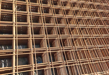 rusty electro-welded net on the building site to favor the pouring of cement and make the construction solid and sturdy