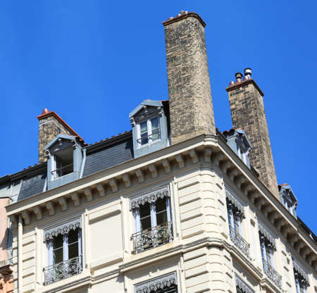 French style chimneys above the roof of the European houses