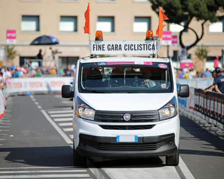 Verona, VR, Italy - June 2, 2019: signaling van with text FINE GARA CICLISTICA which means END OF CYCLING RACE at Tour of Italy also called Giro dItalia Редакционное
