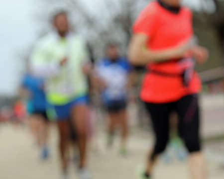 marathons with unrecognizable runners and INTENTIONALLY out of focus to use as a backdrop