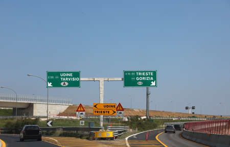 motorway junction with directions to go to the Italian cities of UDINE TARVISIO TRIESTE or GORIZIA Banco de Imagens
