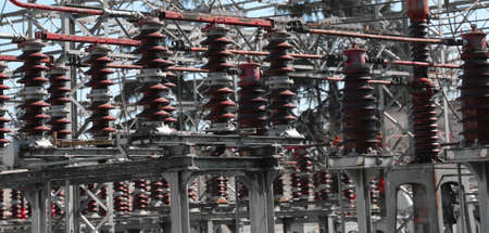 large industrial switches of a power plant with high voltage power lines