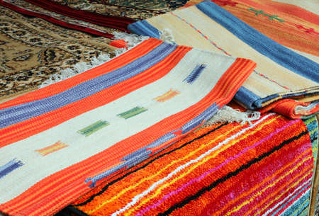 background of Rugs and Carpets in Kilim style for sale at market