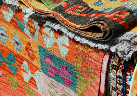 background of kilim rugs or carpets for sale at market