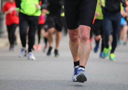 Legs of many Runners during the foot race in the city