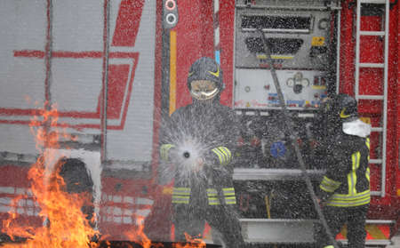 firefighter during an fire drill and a truck Stockfoto