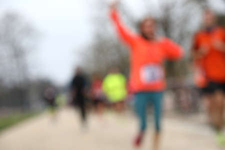 marathons with many unrecognizable runners and INTENTIONALLY out of focus to use as a background