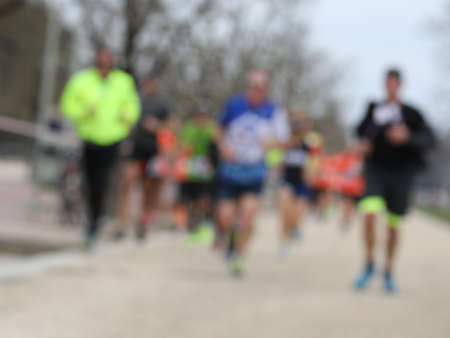 foot race with many unrecognizable runners and INTENTIONALLY BLURRED to use as a background