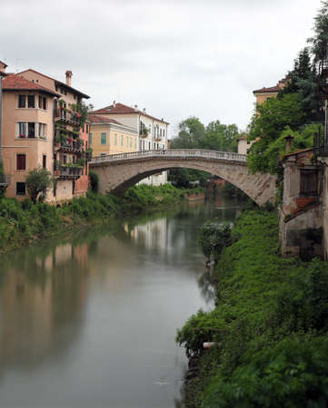 Italian river called Retrone in Vicenza City in Italy and the ancient Bridge of Saint Michael