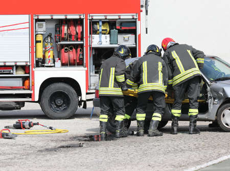 firemen in action after the car road accident