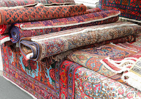 elegant oriental rugs for sale in the market stall on the village street