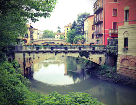 Saint Paul Bridge and Saint Michael Bridge are Two famous bridges in Vicenza City in Italy over the River called Retrone with old toned effect