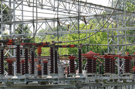 many big industrial breakers and high voltage switches in the power station Stock Photo