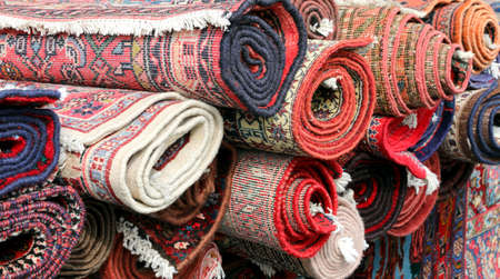 many persian rugs for sale at market