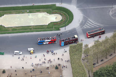 three big open buses fro tourist in the european capital
