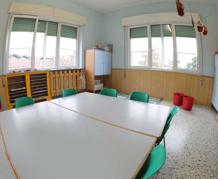 classroom of a school without people and the small green chairs Editorial