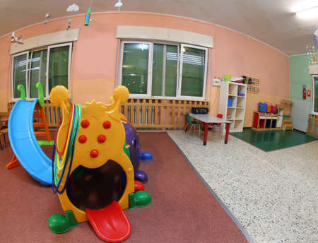 inside the wide hall of a kindergarten the games to entertain children during the day Banque d'images - 124660343