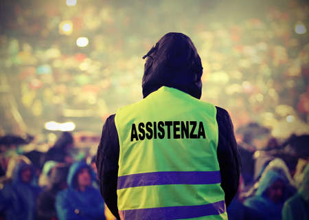 high visibility jacket and refractive inserts with text Assistenza that means assistance in italian language and old toned effect