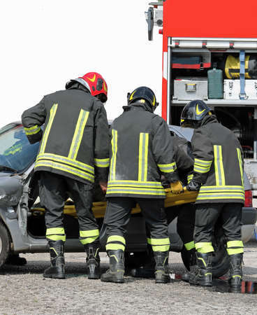 team of firefighters in action after the road accident