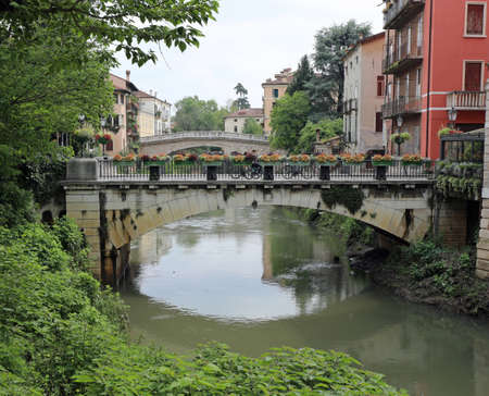 famous bridges called San Michele e San Paolo in Vicenza City in Italy over the Retrone River Imagens