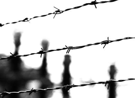 three barbed wires and blurred objects in black and white toned effect
