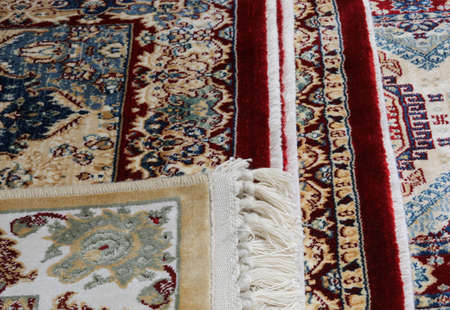 Persian carpet background with geometric decorations for sale in the market