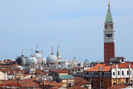Saint Mark bell tower and the domes of Basilica in Venice Italy