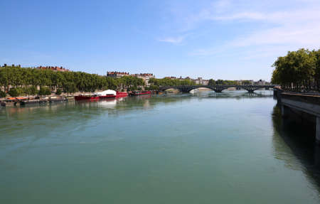 wide river called Rhone in Lyon City in France and a big bridge