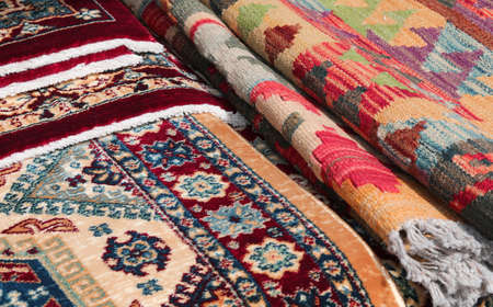background of many Persian type carpets and also kilim type with geometric figures and colorful decorations Stok Fotoğraf