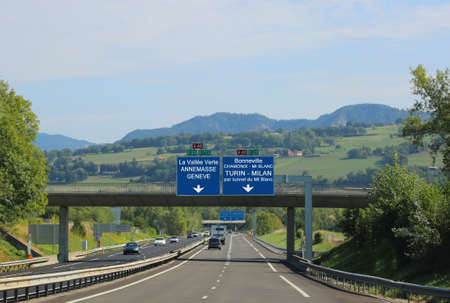 blue road sign with white lettering on the French highway