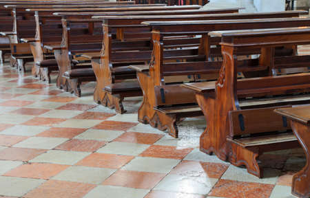 many wooden pews  also called church benches inside a Catholic church