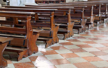 empty church benches made of wooden planks and no believer prays for a profound religious crisis