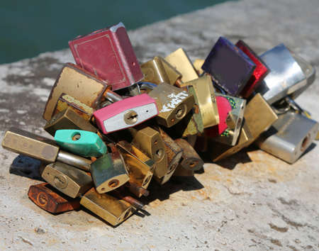 many padlocks in the bridge symbol of sweethearts