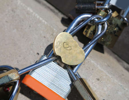 many closed padlocks of sweetheart and one with two hearts Zdjęcie Seryjne