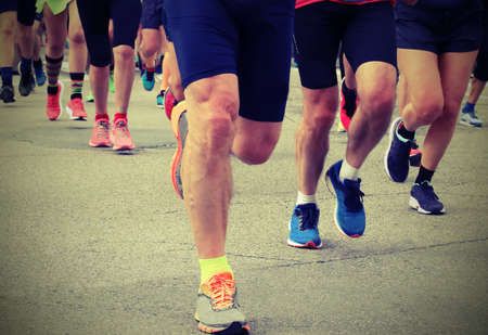 legs of many runners during a race with old toned effect