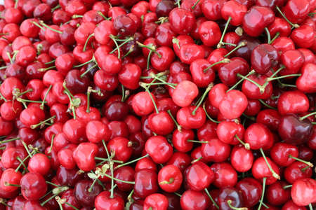 background of many red cherries at fruit market