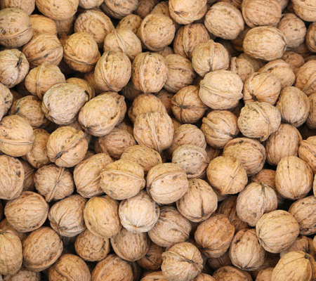 background of organic walnuts for sale at grocery store Фото со стока
