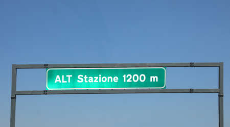 traffic sign with text ALT STATION 1200 meters in Italian language at the end of highway