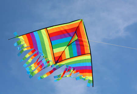 colorful rainbow kite on the blue sky wihtout people Stockfoto