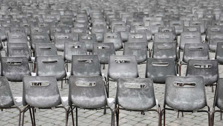 many grey chairs after the event without people